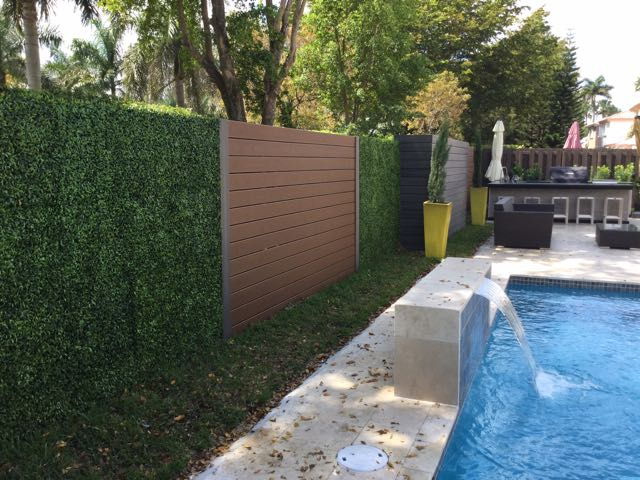 ... Cover Fences, Garages, Columns And Almost Anything With A Flat Surface.  For More Information Regarding Artificial Grass And Ivy Green Walls Or  Visit Our ...